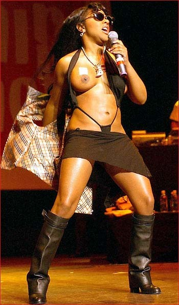 Last night, Lil' Kim was giving a performance when the double-stick tape holding